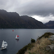 A stunning vista of misty mountain ranges greets Yacht's sailing from Kingston to Queenstown in competition on Lake Wakatipu. The race was to commemorate the voyage by raft of early settler Donald Hay who was the first person known to have made the Kingston to Queenstown crossing, in 1859. Queenstown, South Island, New Zealand. 18th February 2012. Photo Tim Clayton