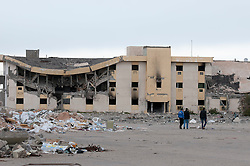 © licensed to London News Pictures. TRIPOLI, LIBYA  19/02/12. People tour Bab Al Azizia, Muarmar Gaddafi's former compound in Tripoli, Libya. Much of it was destroyed by NATO bombing. Please see special instructions for usage rates. Photo credit should read MICHAEL GRAAE/LNP