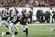 Derek Carr (QB) of the Oakland Raiders to Josh Jacobs (RB) of the Oakland Raiders  during the International Series match between Chicago Bears and Oakland Raiders at Tottenham Hotspur Stadium, London, United Kingdom on 6 October 2019.
