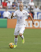JACKSONVILLE, FL - JUNE 07:  Midfielder Michael Bradley #4 of the United States dribbles during the international friendly match against the Nigeria at EverBank Field on June 7, 2014 in Jacksonville, Florida.  (Photo by Mike Zarrilli/Getty Images)