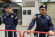27 AUGUST 2013 - BANGKOK, THAILAND:      Thai riot police guard the entrance to the British embassy in Bangkok. About 25 people, including at least two British citizens, picketed the embassy Tuesday morning. They were protesting against former British Prime Minister Tony Blair, who is expected to speak to a political reform commission established by Thai Prime Minister Yingluck Shinawatra. The protest leaders were invited in to the Embassy grounds to speak to representative of the British government. The protest disbanded afterwards. No one was arrested during the protest, which lasted a little over an hour.   PHOTO BY JACK KURTZ