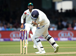 England's Dawid Malan is hit by a ball from Pakistan's Hassan Ali during day three of the First NatWest Test Series match at Lord's, London.