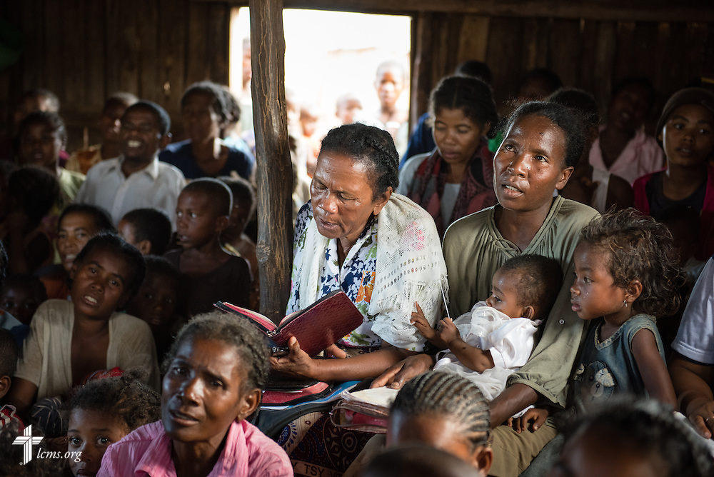 Congregation members sing and pray in a Fiangonana Loterana Malagasy (FLM, Malagasy Lutheran Church) church on Monday, Oct. 20, 2014, near Ambovombe in southern Madagascar. LCMS Communications/Erik M. Lunsford