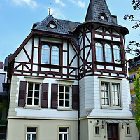 Half Timbered House in Baden-Baden, Germany <br /> The half-timbered framed design, like this one in Baden-Baden, is a common sight throughout Germany.  If you really enjoy this architectural style, then the German Timber-framed Road tour is for you.  However, it requires a significant time commitment because it covers 98 towns in seven regions across 1,864 miles.  The Association of Historic Timber-framed Towns started it in 1990.