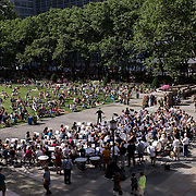 June 21, 2014 - New York, NY : <br /> The city was flooded with music on Saturday as Make Music New York brought more than 1,300 free concerts to the city's streets and parks. The annual festival's program included a performance by the Berlioz Symphony, lead by conductor Jeff W. Ball of the Brooklyn Wind Symphony, in Bryant Park on Saturday afternoon.<br /> CREDIT: Karsten Moran for The New York Times