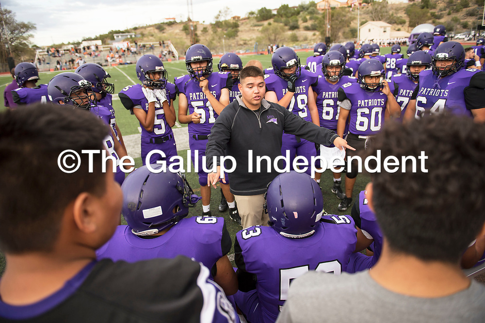 Miyamura Coach Lawrence Garcia talks to the team before the first quarter against the Aztec Tigers, Friday August, 24, 2018 at Angelo DiPaolo Stadium in Gallup.