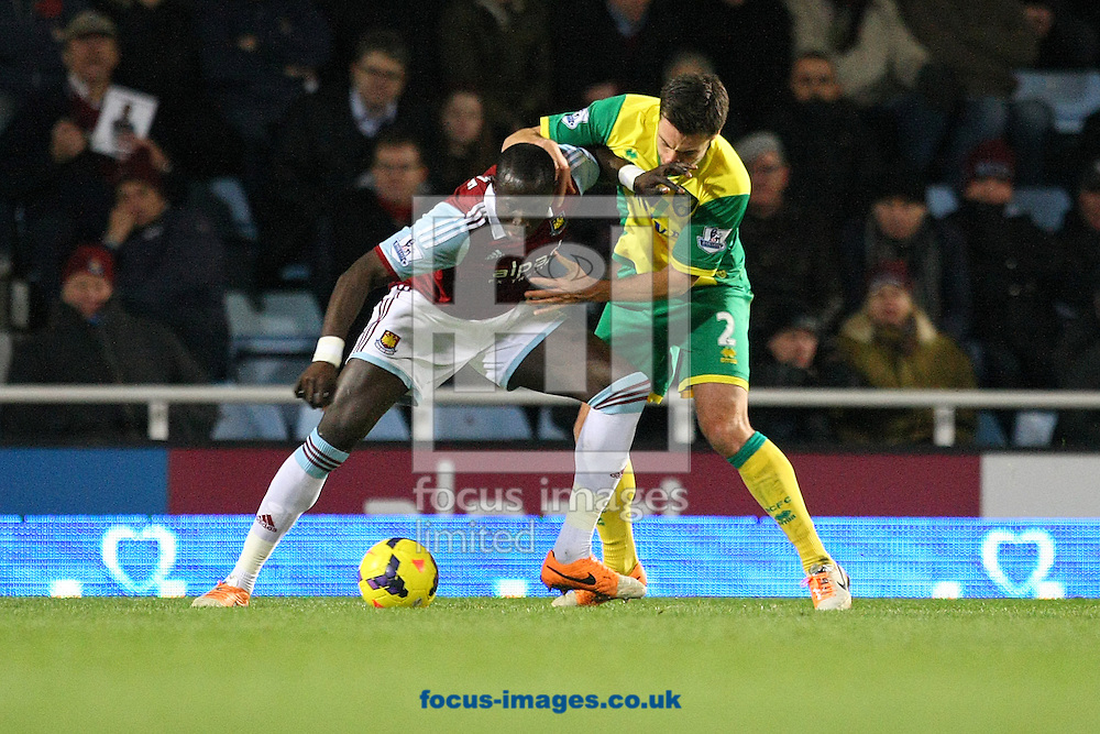 Picture by Paul Chesterton/Focus Images Ltd +44 7904 640267<br /> 11/02/2014<br /> Carlton Cole of West Ham and Russell Martin of Norwich in action during the Barclays Premier League match at the Boleyn Ground, London