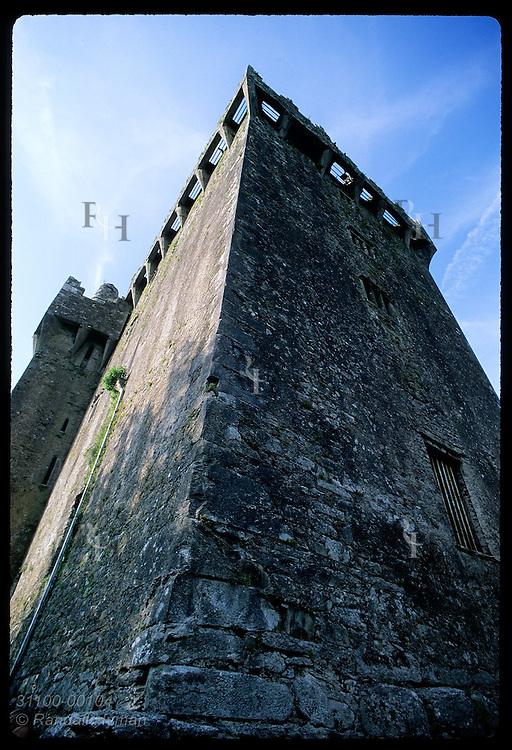 Castle keep (130' tall) soars skyward w/ Blarney Stone wedged at top (rt side); Blarney Castle Ireland