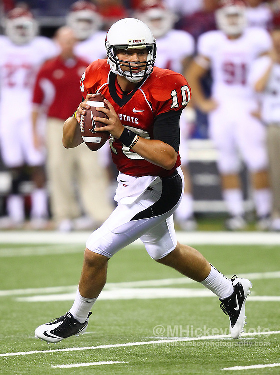 Sept. 03, 2011; Indianapolis, IN, USA; Ball State Cardinals quarterback Keith Wenning (10) scrambles out of the pocket against the Indiana Hoosiers at Lucas Oil Stadium. Mandatory credit: Michael Hickey-US PRESSWIRE