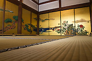 In almost all Japanese homes, temples and restaurants, one can find fusuma, which slide from side to side to redefine spaces within a room, and also act as doors. They typically measure about the same size as a tatami mat, and are two or three centimeters thick. They consist of a wooden frame, covered in cardboard and a layer of paper. They typically have a black lacquer border and an indented door handle. Historically, fusuma were painted, often with scenes from nature such as mountains, forests or animals.