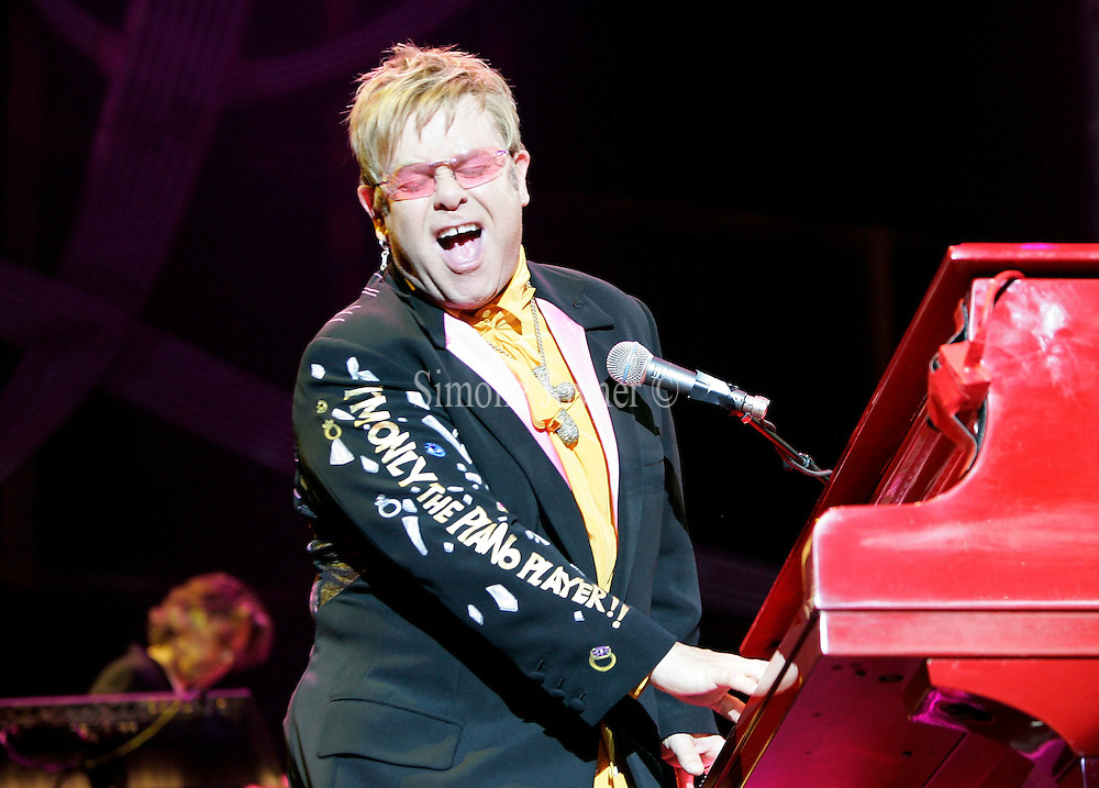 Sir Elton John performs live on stage at the O2 arena on September 5, 2007 in London, England. (Photo by Simone Joyner)
