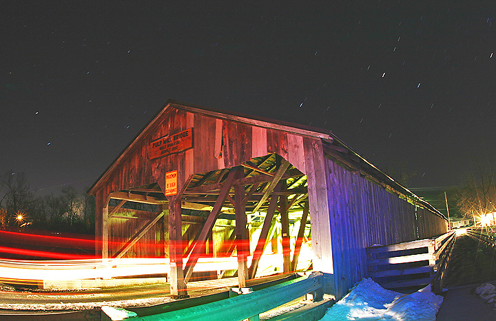 Shot I took of an old covered bridge in Vermont.  I flashed the bridge red, blue and green gels to add the colors.