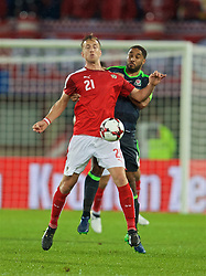 VIENNA, AUSTRIA - Thursday, October 6, 2016: Wales' captain Ashley Williams in action against Austria's Marc Janko during the 2018 FIFA World Cup Qualifying Group D match at the Ernst-Happel-Stadion. (Pic by David Rawcliffe/Propaganda)