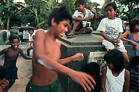 In spite of their living conditions the children of Cavite City Cemetery create games that keep them entertained among the tombstones.(Janet Jensen/The News Tribune)