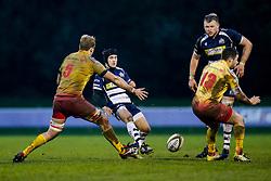 Bristol Rugby Fly-Half Matthew Morgan chips through as Scarlets XV Lock Jack Jones (capt) challenges - Mandatory byline: Rogan Thomson/JMP - 17/01/2016 - RUGBY UNION - Clifton Rugby Club - Bristol, England - Scarlets Premiership Select XV v Bristol Rugby - B&I Cup.