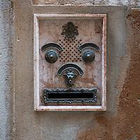 Smiley greetings door bell, Venice, Italy.