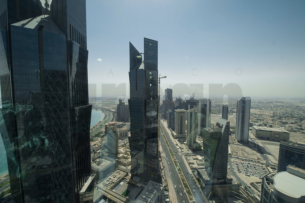09 APR 2013, DOHA/QATAR<br /> Suedlicher Teil von Downtown Doha mit den zwei Tuermen der Palm Towers (links), aus dem Büro der Qatar Foundation im Tornado Tower<br /> IMAGE: 20130409-01-027<br /> KEYWORDS: Katar, Skyline, Skyscrapers, Wolkenkratzer