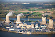 Three Mile Island, the site of America's worst nuclear accident to date, currently continues to operate one of its two reactors (left), as shown by the condensation leaving its cooling towers.  The damaged reactor (right) took 12 years and cost nearly $1 billion to clean up.