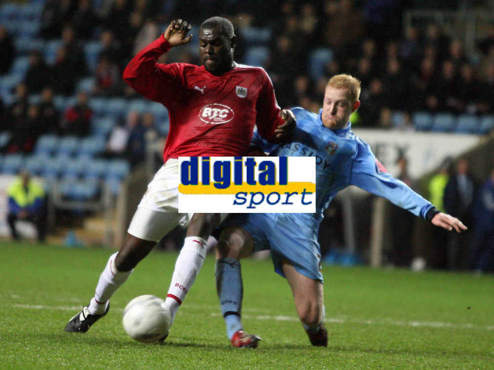 Photo: Rich Eaton.<br /> <br /> Coventry City v Bristol City. The FA Cup. 16/01/2007. Enoch Showumni left of Bristol shots as Andrew Whing of Coventry tries to block