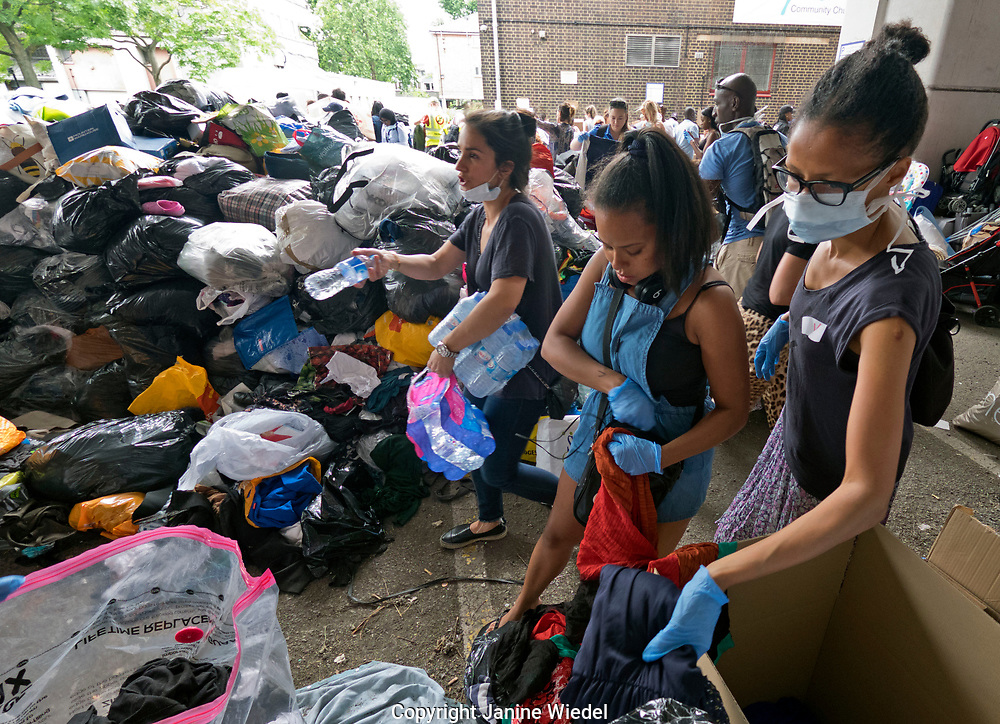 Volunteers at  Latimer Road sorting and distributing goods donated by people from all over London in the aftermath of the fire that destroyed the 24-story Grenfell Tower in North Kensington, London on 14th June 2017.  The death toll officially at 75 but will no doubt rise to three figures.