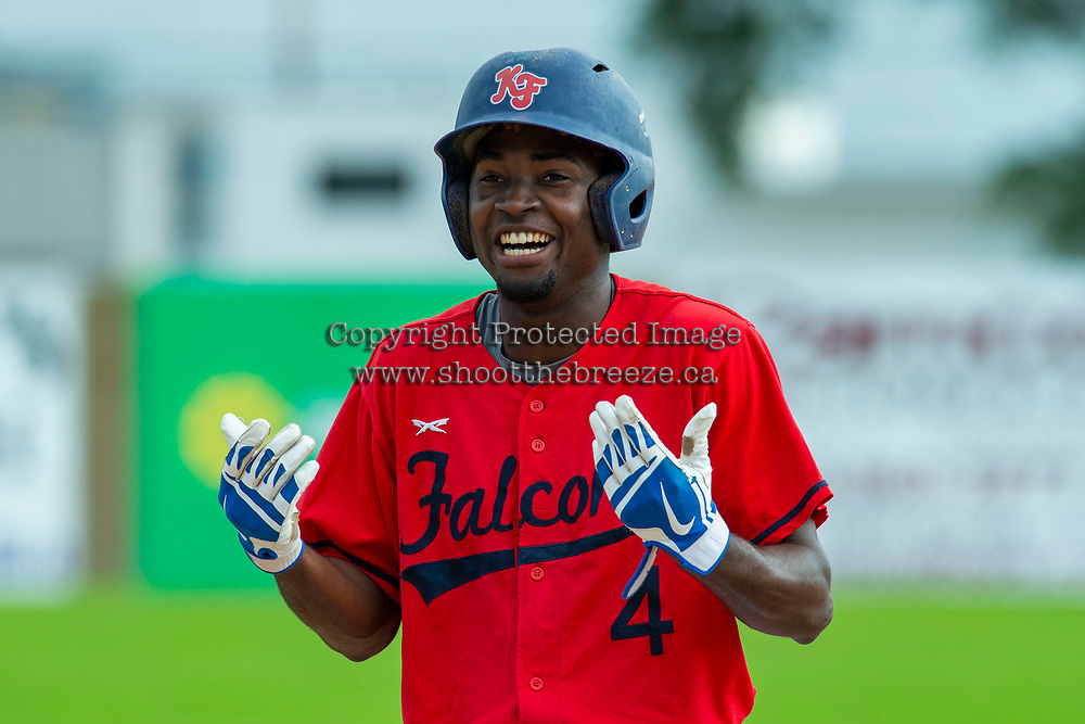 KELOWNA, BC - JULY 06:  Richi Sede #4 of the Kelowna Falcons stands on first base after hitting the first single against the Walla Walla Sweets and motions to the dugout for applause from teammates at Elks Stadium on July 6, 2019 in Kelowna, Canada. (Photo by Marissa Baecker/Shoot the Breeze)