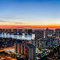 Aerials of view of Sunny Isles Beach at twilight looking south and west to Aventura.