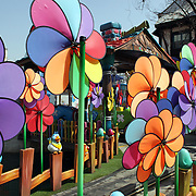 Colorful wind mills at the outdoor amusement park at Lotte World. Lotte World is the world's largest indoor theme park which includes shopping malls, a luxury hotel, and an Ice rink. Opened on July 12, 1989, Lotte World receives over 8 million visitors each year. Seoul, South Korea. 21st March 2012. Photo Tim Clayton
