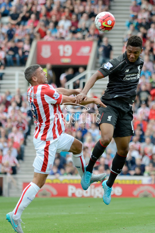 Joe Gomez wins a header during the Barclays Premier League match between Stoke City and Liverpool at the Britannia Stadium, Stoke-on-Trent, England on 9 August 2015. Photo by Alan Franklin.
