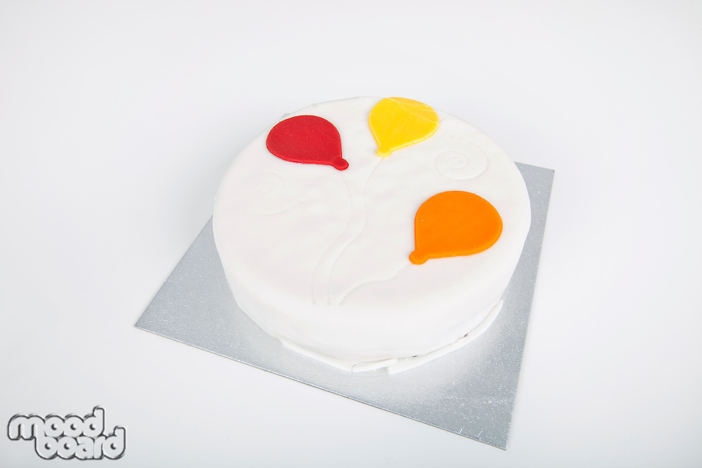 High angle view of birthday cake over white background