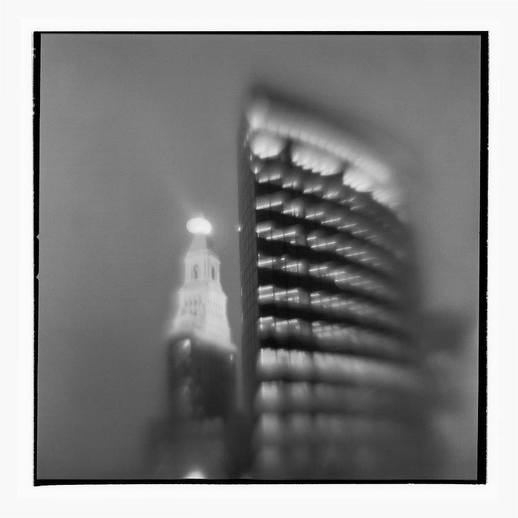 USA, Connecticut, Hartford, Blurred black and white image of Phoenix Building and city skyline at dusk