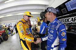 November 16, 2018 - Homestead, Florida, U.S. - Kyle Busch (18) and Matt Kenseth (6) hang out in the garage prior to practice for the Ford 400 at Homestead-Miami Speedway in Homestead, Florida. (Credit Image: © Justin R. Noe Asp Inc/ASP)