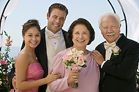 Bride and Groom with parents outdoors (portrait)