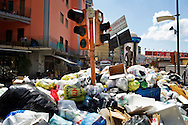 ITALY, NAPLES : Piles of uncollected garbage are seen in downtown Naples on May 9, 2011. Garbage has been accumulating on the streets of the the souther italian city for the last weeks. The italian government sent the army in order to face this nes emergency..AFP PHOTO / ROBERTO SALOMONE