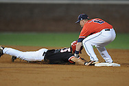 Mississippi's Kevin Mort (6) tags out St. John's Scott Ferrara (15) for an out and throws to first for a double play during an NCAA Regional at Davenport Field in Charlottesville, Va. on Friday, June 4, 2010.