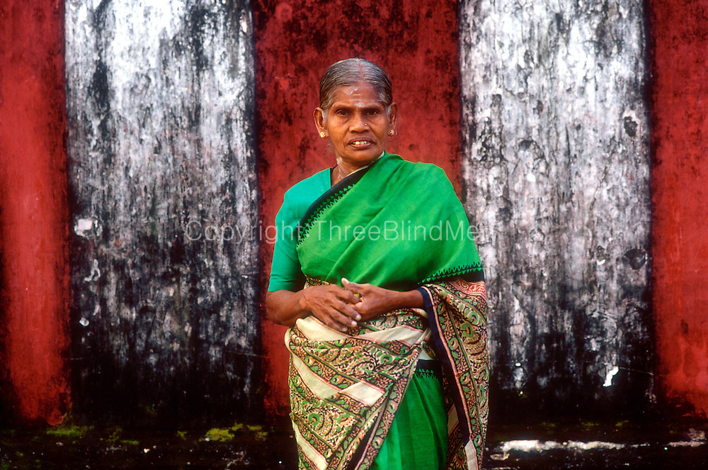 Jaffna. Woman in green sari standing against wall of the Nallur Temple...March 2002