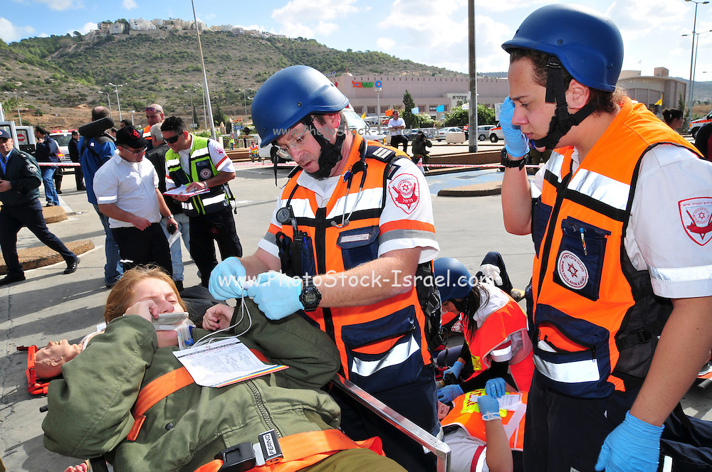 Israel, Haifa Israeli security forces and rescue personnel attend an exercise simulating a terror attack at the Haifa Mall November 3, 2009. Wounded being treated by first aid crew