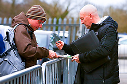 Grimsby Town manager Ian Holloway signs a programme for a fan - Mandatory by-line: Ryan Crockett/JMP - 04/01/2020 - FOOTBALL - One Call Stadium - Mansfield, England - Mansfield Town v Grimsby Town - Sky Bet League Two