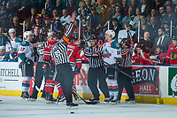 KELOWNA, CANADA - APRIL 8: Referees Mike Campbell and Mark Pearce make penalty calls as linesmen Dustin Minty and Ron Dietterle attempt to separate players of the Kelowna Rockets and the Portland Winterhawks on April 8, 2017 at Prospera Place in Kelowna, British Columbia, Canada.  (Photo by Marissa Baecker/Shoot the Breeze)  *** Local Caption ***