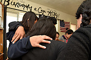 Tucson, Arizona, USA.  9 Jan, 2019. Asylum seekers, who entered the USA from Mexico through the port-of-entry at Nogales, Arizona, receive shelter and services at Casa Alitas operated by Catholic Community Services of Southern Arizona, Inc.  After processing, where adults were fitted with ankle bracelets and assigned a hearing date, the dozen migrants, including adults and children from Guatemala and Mexico, were brought to the shelter by Department of Homeland Security agents.  After a brief stay at the shelter, they will travel to the location of their sponsor until their hearing date.  Casa Alitas is one of many shelters caring for migrants.  Asylum seekers join in prayer shortly after arriving at the shelter.  Credit:  Norma Jean Gargasz/Alamy Live News