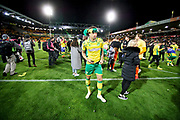 Norwich City midfielder Ben Godfrey (4) celebrates promotion to the Premier League after the EFL Sky Bet Championship match between Norwich City and Blackburn Rovers at Carrow Road, Norwich, England on 27 April 2019.