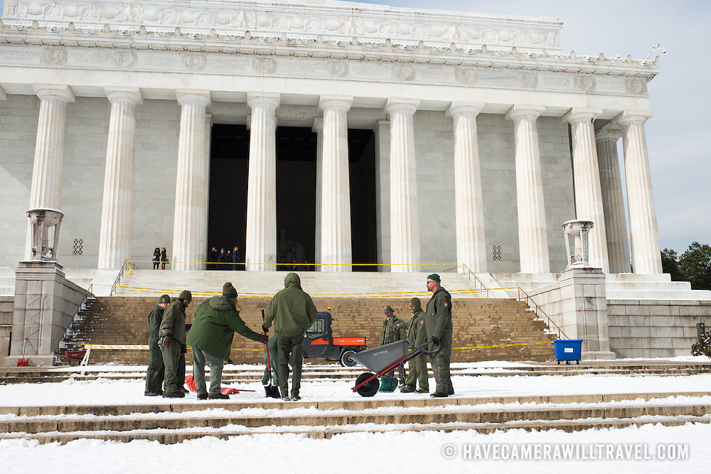 National Park Service works clear snow and ice from the steps of the Lincoln Memorial after a snow storm.