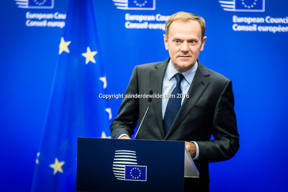 Brussels Belgium  9 november 2016  Donald Tusk congratualets Donald Trump during a decleration at the European Commission for the press in Brussels in front of a blue screen with EU logos and flags