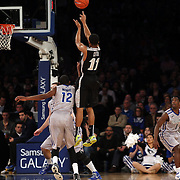 Bryce Cotton, Providence, shoots three during the Creighton Bluejays Vs Providence Friars basketball game during the Big East Conference Tournament Final at Madison Square Garden, New York, USA. 15th March 2014. Photo Tim Clayton