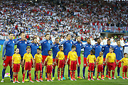 England players sing the national anthem during the Euro 2016 Group B match between Slovakia and England at Stade Geoffroy Guichard, Saint-Etienne, France on 20 June 2016. Photo by Phil Duncan.