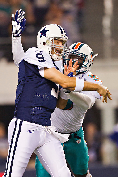 ARLINGTON, TX - NOVEMBER 24:   Tony Romo #9 of the Dallas Cowboys is hit while throwing a pass against the Miami Dolphins at Cowboys Stadium on November 24, 2011 in Arlington, Texas.  The Cowboys defeated the Dolphins  20 to 19.  (Photo by Wesley Hitt/Getty Images) *** Local Caption *** Tony Romo