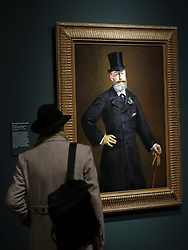 A visitor admires Portrait of M. Antonin Proust,  at a preview of the new Edouard Manet portraiture exhibition at the Royal Academy of Arts in London, Tuesday, 22nd January 2013.Photo by: Stephen Lock / i-Images