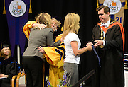 Gonzaga President Thayne M. McCulloh and School of Law Dean Jane Korn present Molly DeCastro and Jody Clute with the Law Medal in honor of their father, former School of Law Dean, John Clute.