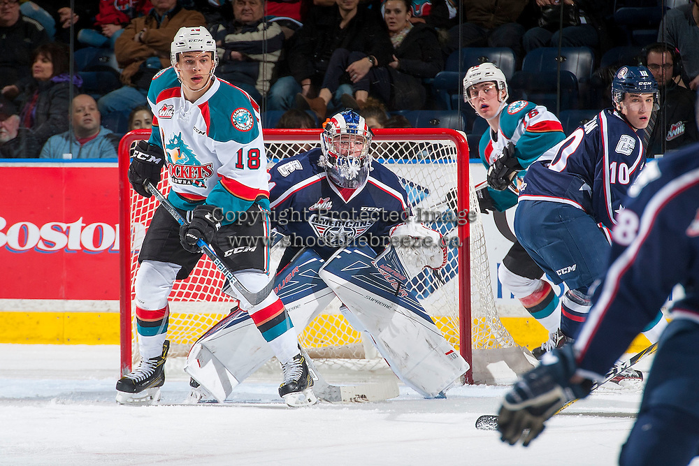 KELOWNA, CANADA - MARCH 4: Carsen Twarynski #18 of the Kelowna Rockets looks for the pass in front of the net of Evan Sarthou #31 of the Tri-City Americans on March 4, 2017 at Prospera Place in Kelowna, British Columbia, Canada.  (Photo by Marissa Baecker/Shoot the Breeze)  *** Local Caption ***