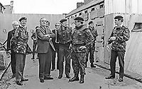 Secretary of State for N Ireland, William Whitelaw, visits British troops serving in Londonderry, N Ireland.  Also in the photo (on the left) is Major General Robert Ford. 1972081201WW1.<br /> <br /> Copyright Image from Victor Patterson,<br /> 54 Dorchester Park, <br /> Belfast, UK, BT9 6RJ<br /> <br /> t1: +44 28 9066 1296 (from Rep of Ireland 048 9066 1296)<br /> t2: +44 28 9002 2446 (from Rep of Ireland 048 9002 2446)<br /> <br /> m: +44 7802 353836<br /> <br /> e: victorpatterson@me.com<br /> www.victorpatterson.com<br /> <br /> Please see my Terms and Conditions of Use at www.victorpatterson.com. It is IMPORTANT that you familiarise yourself with them.<br /> <br /> Images used on the Internet must be visibly watermarked i.e. © Victor Patterson<br /> within the body of the image and copyright metadata must not be deleted. Images <br /> used on the Internet have a size restriction of 4kbs and will be chargeable at current<br />  NUJ rates unless agreed otherwise.<br /> <br /> This image is only available for the use of the download recipient i.e. television station, newspaper, magazine, book publisher, etc, and must not be passed on to any third <br /> party. It is also downloaded on condition that each and every usage is notified within 7 days to victorpatterson@me.com<br /> <br /> The right of Victor Patterson to be identified as the author is asserted in accordance with The Copyright Designs And Patents Act (1988). All moral rights are asserted.