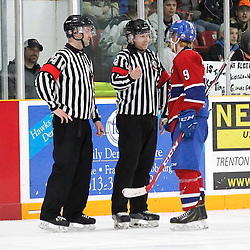 TRENTON, - Apr 2, 2016 -  Ontario Junior Hockey League game action between the Trenton Golden Hawks and the Kingston Voyageurs. Game 3 of the North East Champonship series, Jacob Hanlon #9 of the Kingston Voyageurs speaks to the OHA Referees during the third period at the Duncan Memorial Gardens, ON. (Photo by Amy Deroche / OJHL Images)